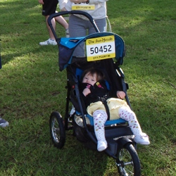 Mini-Miss in her racing pram