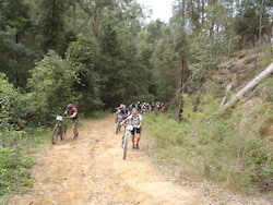 Riders walking up hill