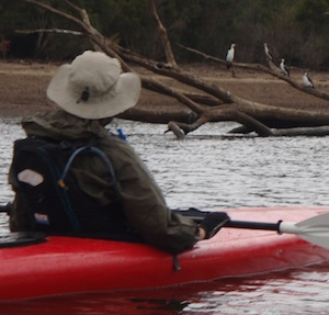 Paddler wearing a PFD with bladder